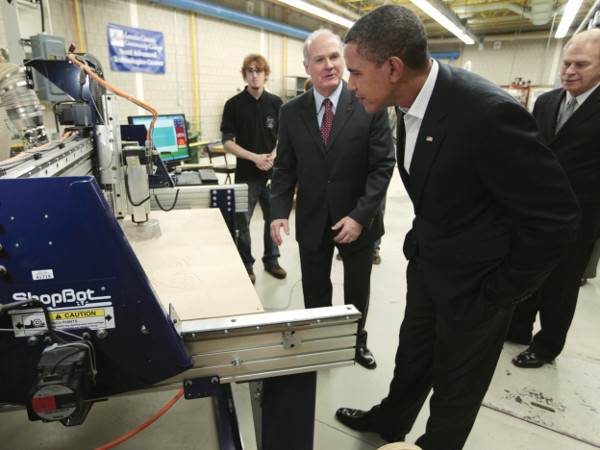 """President Barack Obama visits a wind turbine manufacturing and fabrication lab at Lorain County Community College in Elyria, Ohio, Friday, Jan. 22,2010, as part of his """"White House to Main Street Tour"""". (AP Photo/Charles Dharapak)"""
